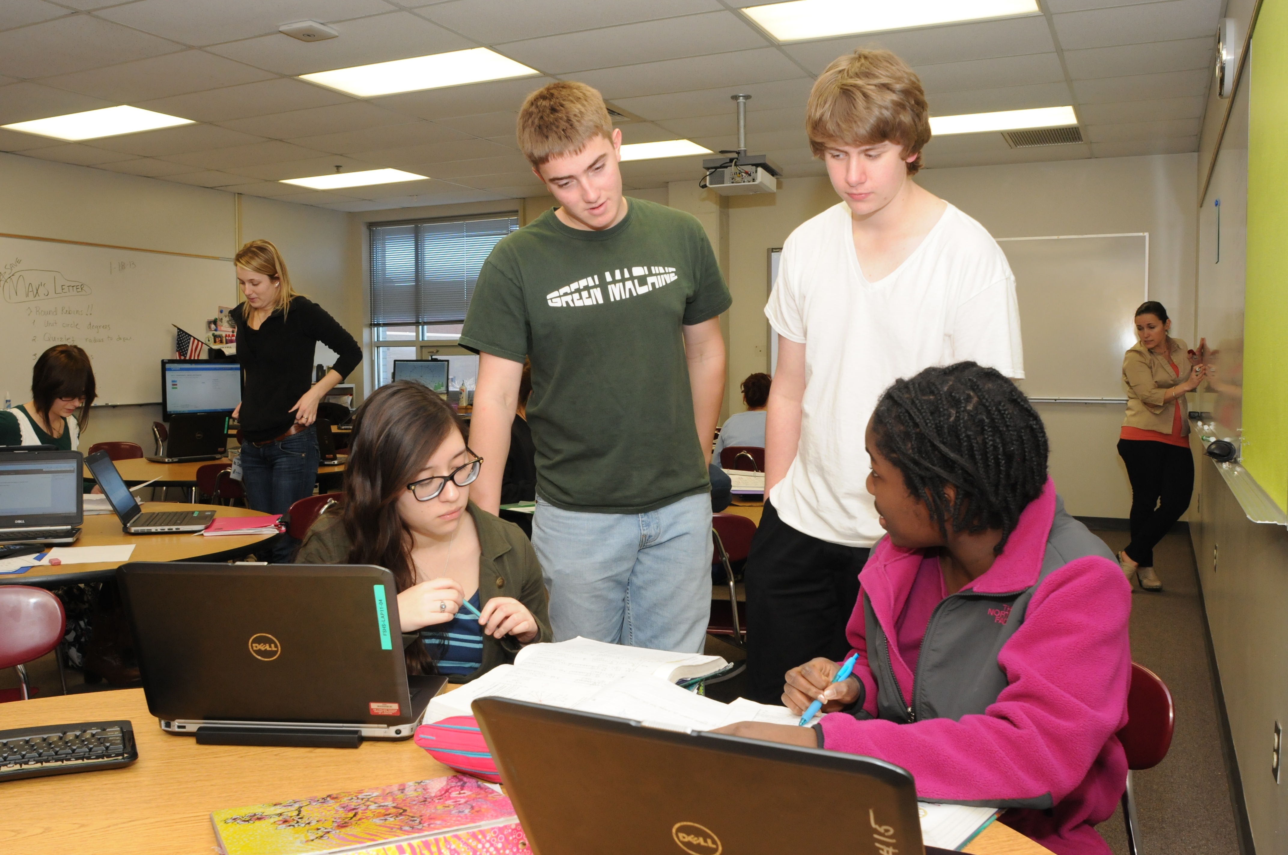 Students discussing in a blended learning classroom
