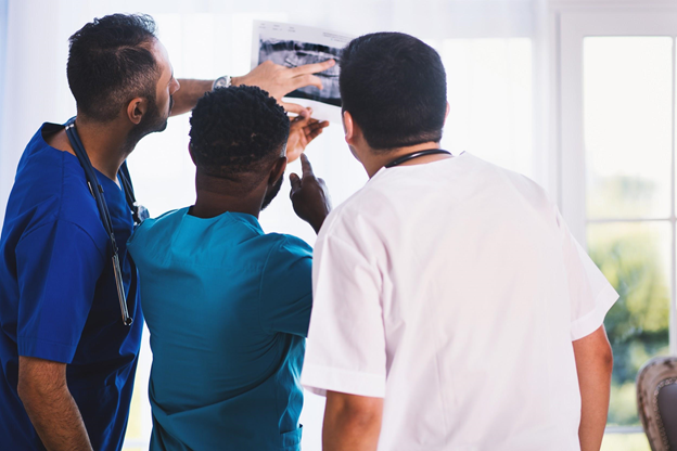 healthcare workers looking at x-ray