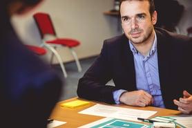 Man speaking at desk