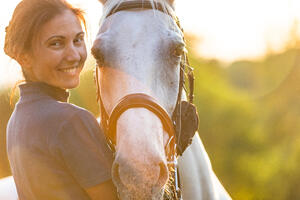 woman petting a horse.