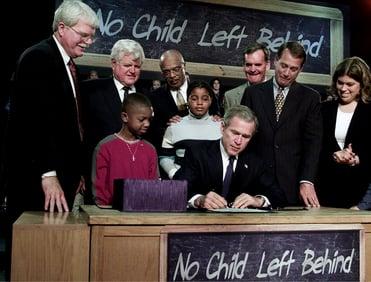 President George W. Bush signs bill into law