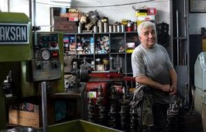older worker in shop.