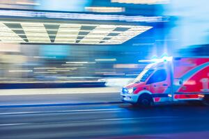 Ambulance driving past hospital.