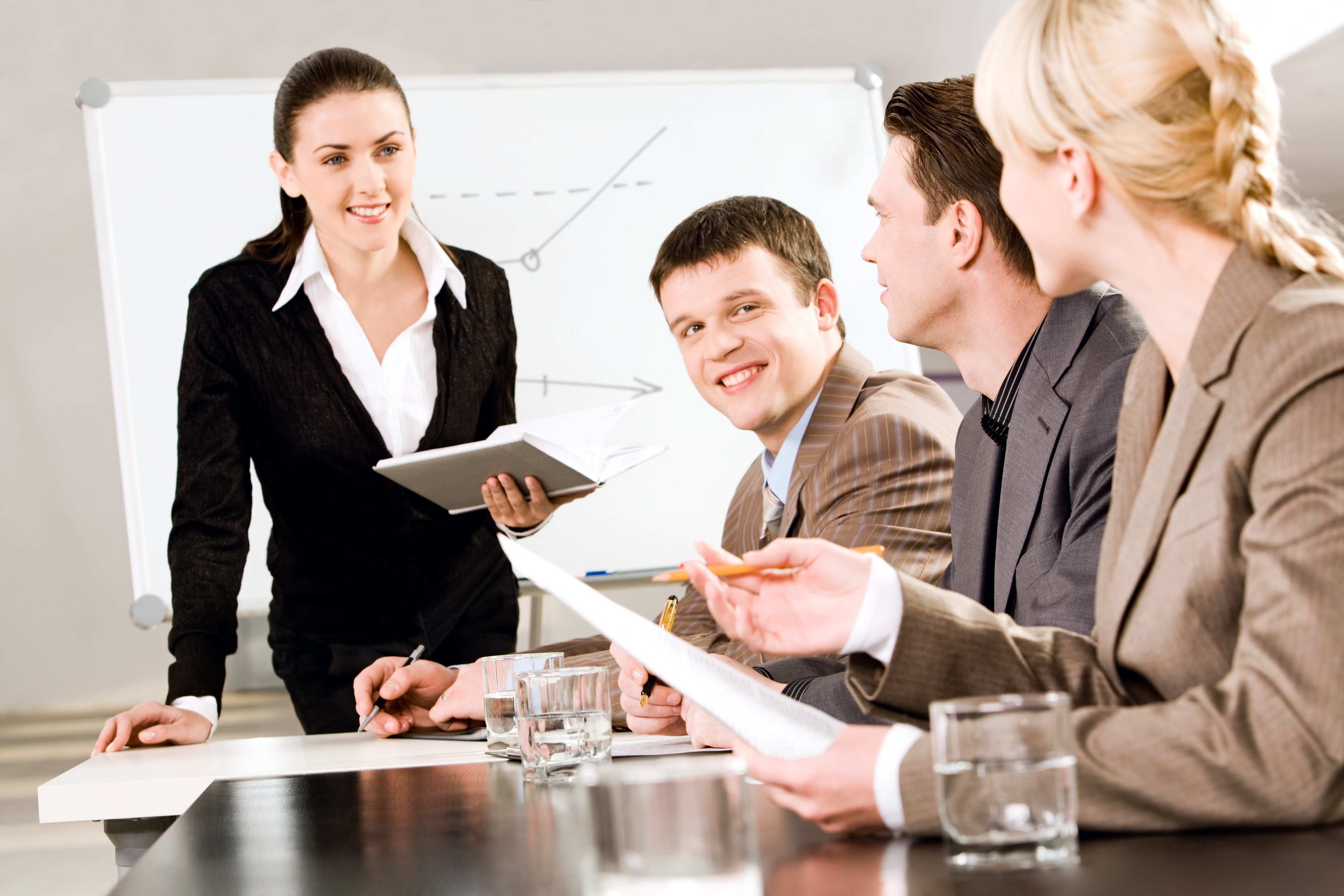 Colleagues interacting in a meeting
