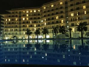 luxury hotel and pool at night.