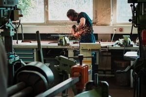 man welding in shop