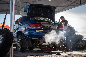 mechanic working on car.