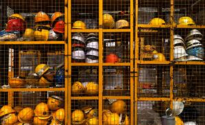 open lockers with safety helmets.